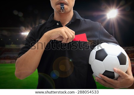 The referee gave a red card for the player in stadium - stock photo