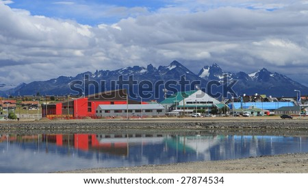 The reflection of houses in Ushuaia - stock photo