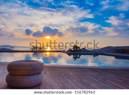 The reflection of the beautiful clouds in the pool at sunset and the island ... Greece. - stock photo