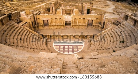 The remainings of an ancient amphitheater in the ruins of Roman Jerash in todays Jordan - stock photo
