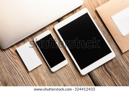 The responsive design mockup on wooden background - stock photo