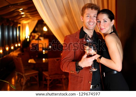 the restaurant hugging young man and beautiful woman - stock photo