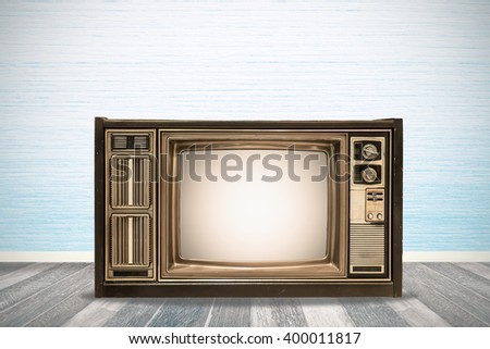 The retro TV on vintage room  - stock photo