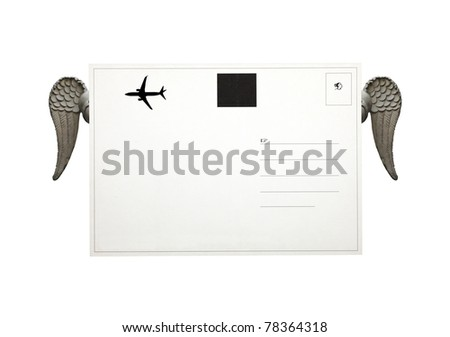 The reverse of a blank air-mail postcard with a pair of exotic angel wings and copyspace for text. - stock photo