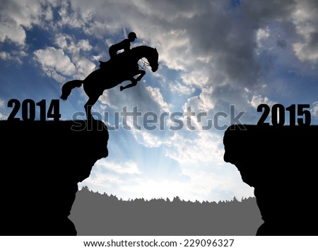 The rider on the horse jumping into the New Year 2015  - stock photo