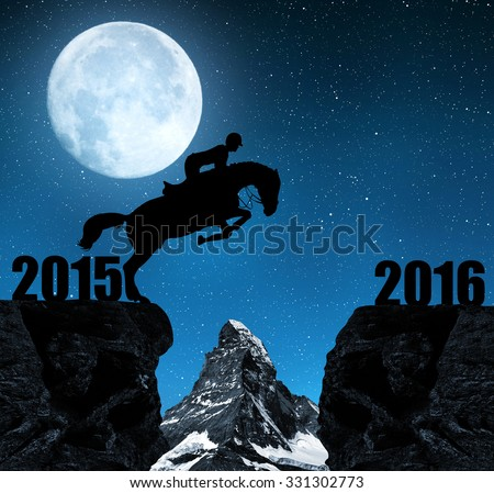 """The rider on the horse jumping into the New Year 2016. In the background Matterhorn. """"Elements of this image furnished by NASA"""".  - stock photo"""