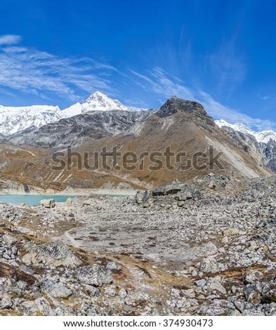 The ridge Mahalangur Himal with Cho Oyu peak (8201 m). View from Thopak Tsho (4990 m) - Gokyo region, Nepal, Himalayas - stock photo