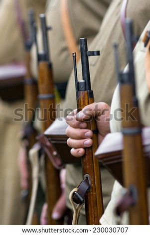 the rifle in hand - stock photo