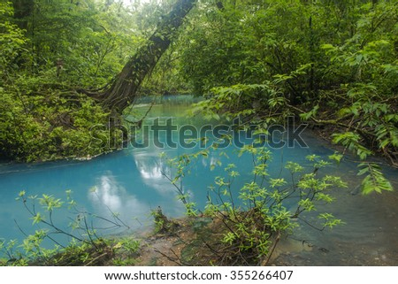 The Rio Celeste meandering through the jungle in Costa Rica - stock photo