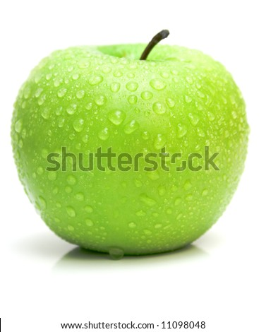 The ripe juicy apple covered by drops of water. Isolation on white, shallow DOF. - stock photo