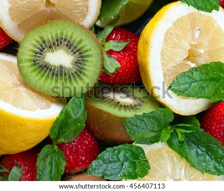 The ripe juicy fruits and peppermint leaves - stock photo