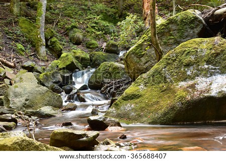 the River Ilse at Ilsenburg in the Harz National Park at the foot of the Brocken - stock photo
