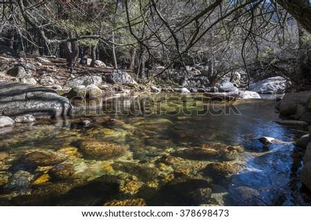 The River Manzanares along its course through La Pedriza, in Guadarrama Mountains National Park, Madrid, Spain - stock photo