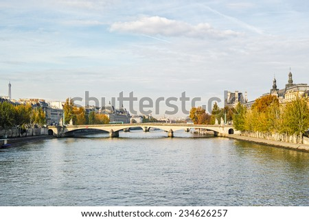 The river Seine in autumn, Paris France - stock photo