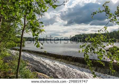The river with a rapid current in the summer, Russia, Ural Mountains - stock photo