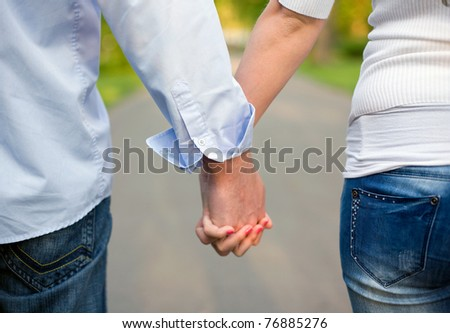 The road ahead, young couple holding hands. - stock photo