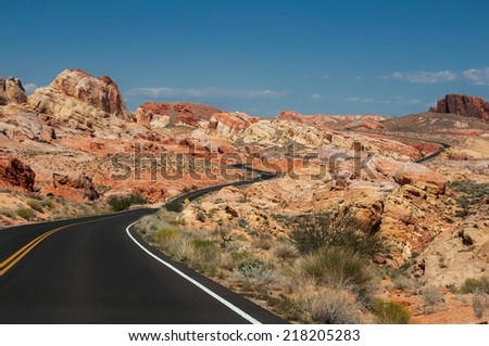 The road, going through the bright rocks of Valley of Fire State Park, located near Las Vegas, USA - stock photo