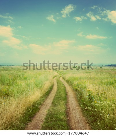 the road in rural areas. Retro stale. - stock photo