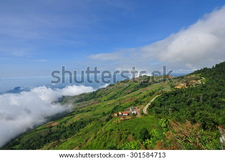 the road in the mountains at Thailand - stock photo