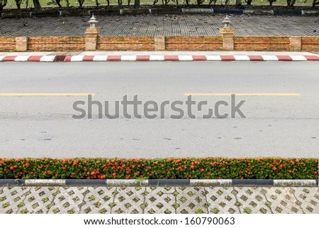The road in the park with footpath. - stock photo