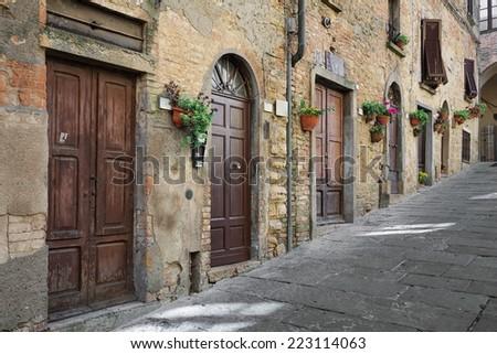 The road leading to the main square - Piazza dei Priori, Volterra Tuscany Italy - stock photo