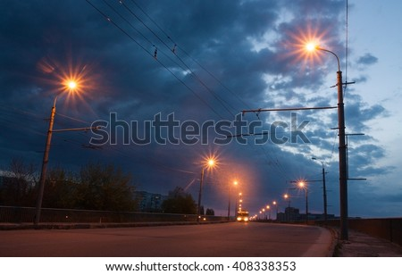 The road lighting in a small town at dawn - stock photo