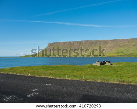 The road pass through mountain and field landscape in summer of Iceland - stock photo