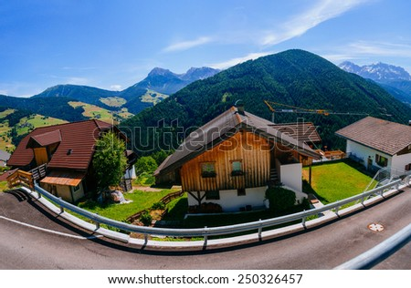 The road that runs through the town in the mountains. - stock photo
