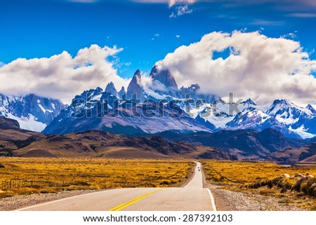 The road through desert. The highway crosses Patagonia and conducts to majestic Mountains Fitzroy - stock photo