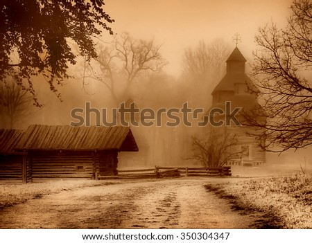 The road to the church and old house. Art photo in sepia. - stock photo