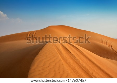 The road to the dunes Dubai - stock photo