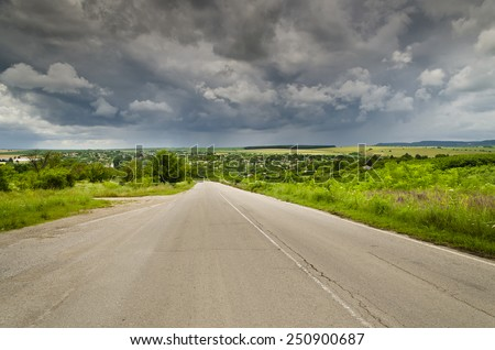 The road to the storm in the northern Bulgaria - stock photo