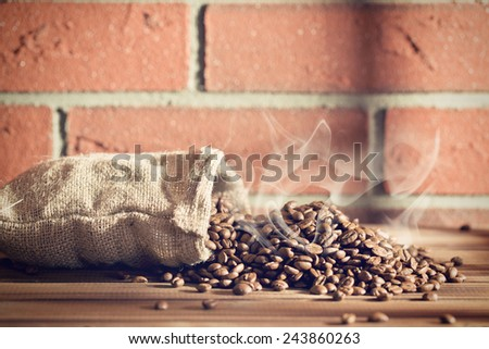 the roasted coffee beans in burlap sack - stock photo