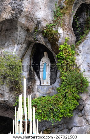 The rock cave at Massabielle with the statue of the Virgin Mary - stock photo