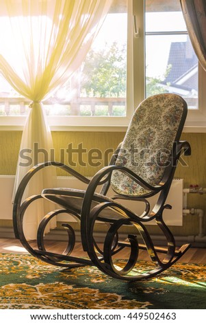 The rocking chair in the living room beside the window - stock photo