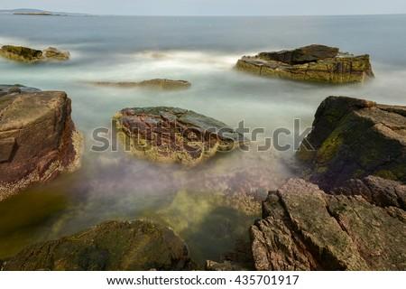 The rocky coast in Acadia National Park, Maine near Thunder Hole in the summer. - stock photo