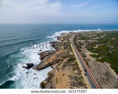 The rocky coastline of Cascais, Portugal. - stock photo