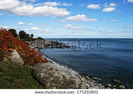 The rocky coastline of the state of New Hampshire. - stock photo