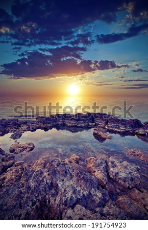 The rocky shore of the sea calm and gentle sunset. Vintage style - stock photo