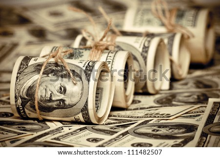 The roll of US federal reserve notes $100. Old style photo. - stock photo