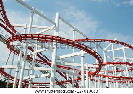 the roller coaster track  on blue sky - stock photo