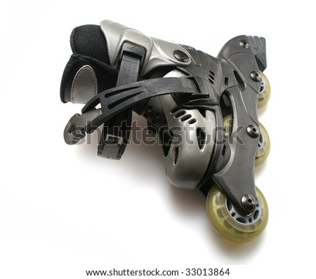 The roller skates on the white table - stock photo