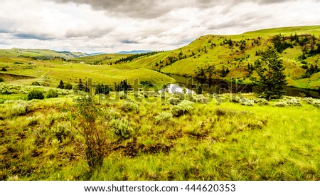 The Rolling Hills and Grasslands in the Nicola Valley between the towns of Merritt and Kamloops British Columbia, Canada - stock photo