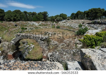 The Roman amphitheater, Neapolis Archaeological Park, tourist attraction in Siracusa, Sicily, Italy - stock photo