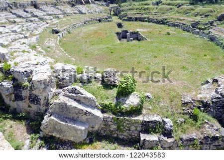 The Roman amphitheatre, near Syracuse on Sicily, Italy. - stock photo