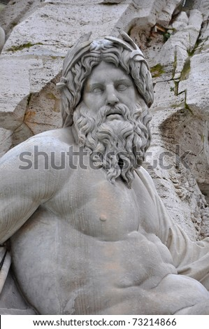 The roman god neptune / zeus on a fountain in Rome - stock photo