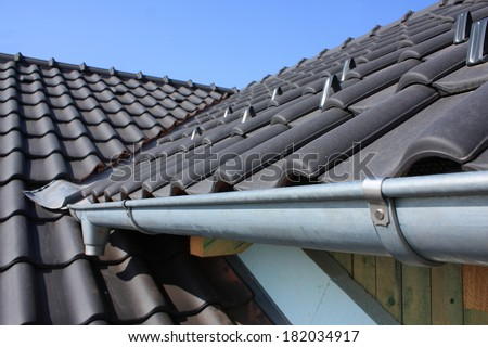The roof is covered with black roofs of clay tiles - stock photo