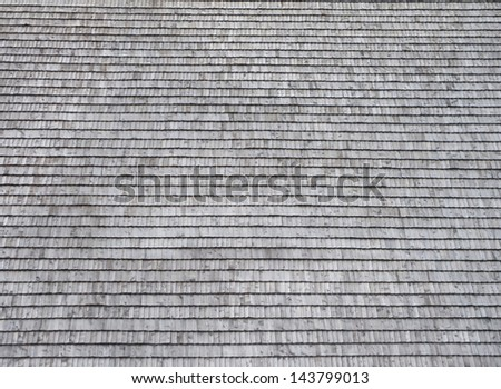 The roof is covered with wooden shingles as background - stock photo