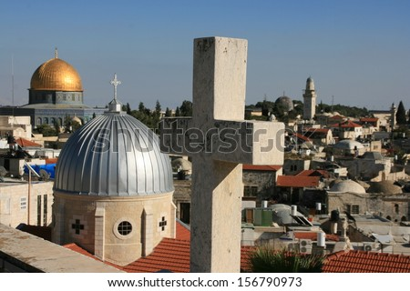 The roofs of the old city of Jerusalem with the Dome of the Rock in the background. - stock photo