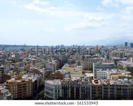 The rooftops of a city seen from above. - stock photo